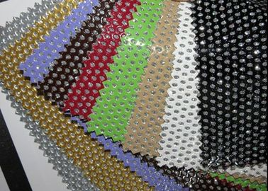 China Hole Punch Pattern PU Black Perforated Leather Fabric With Nonwowoven Backing supplier